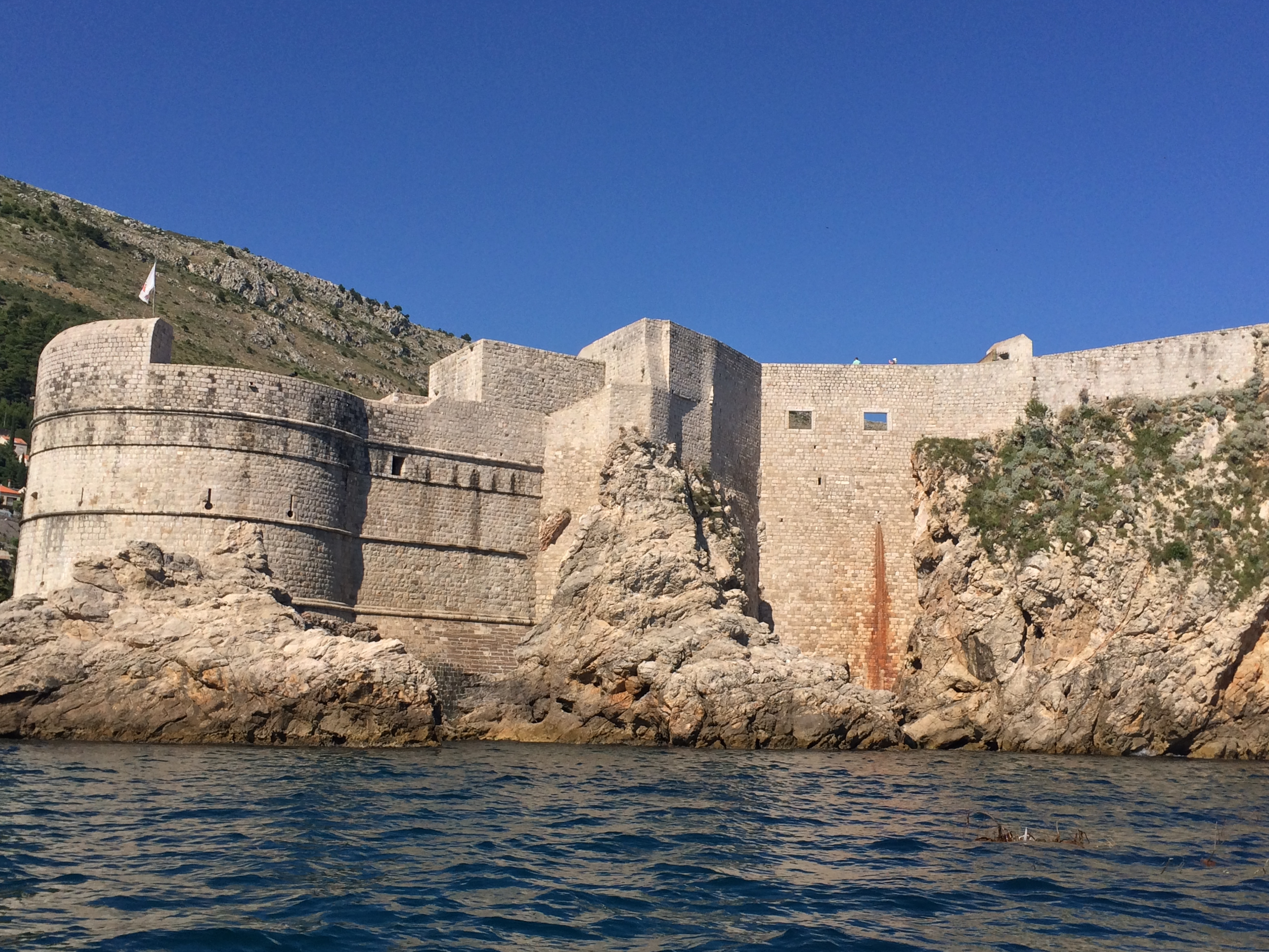 Mighty walls of Dubrovnik from a canoe